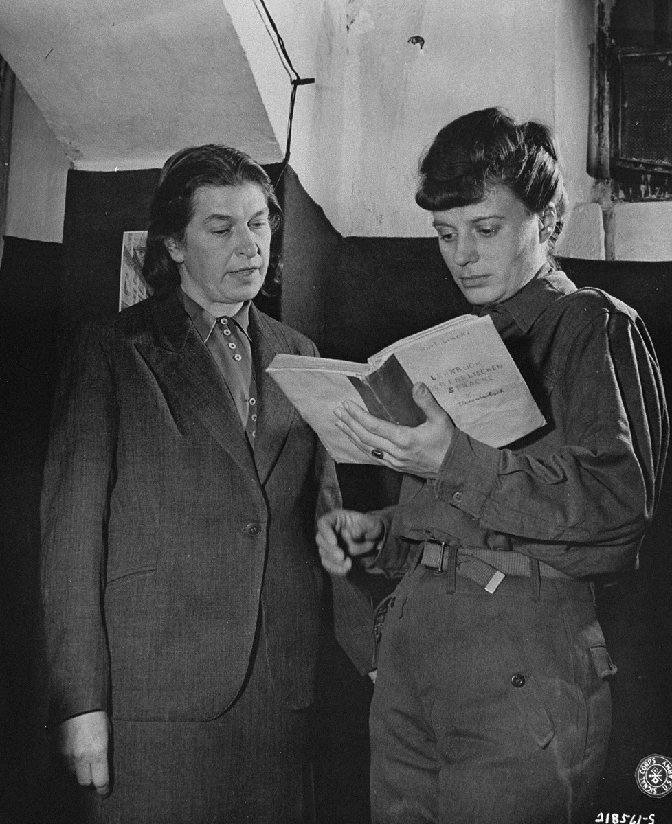 Johanna Wolf (left), Adolf Hitler's former secretary, and Ingeborg Sperr (right), Rudolf Hess's former secretary, practice their English while waiting to testify at the International Military Tribunal trial of war criminals at Nuremberg.