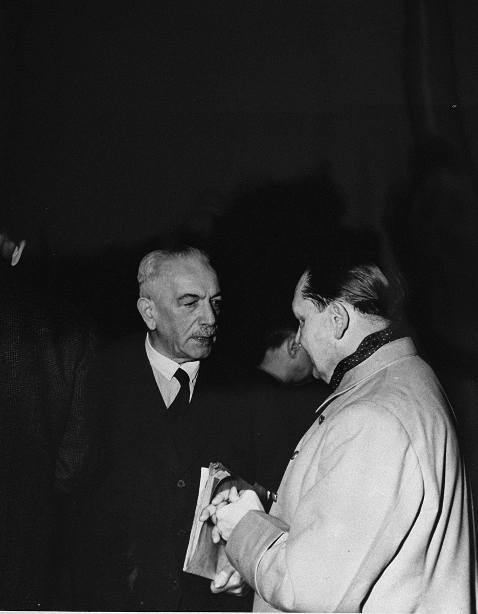 Defendants Constantin von Neurath and Hermann Goering talk during a recess at the International Military Tribunal trial of war criminals at Nuremberg.