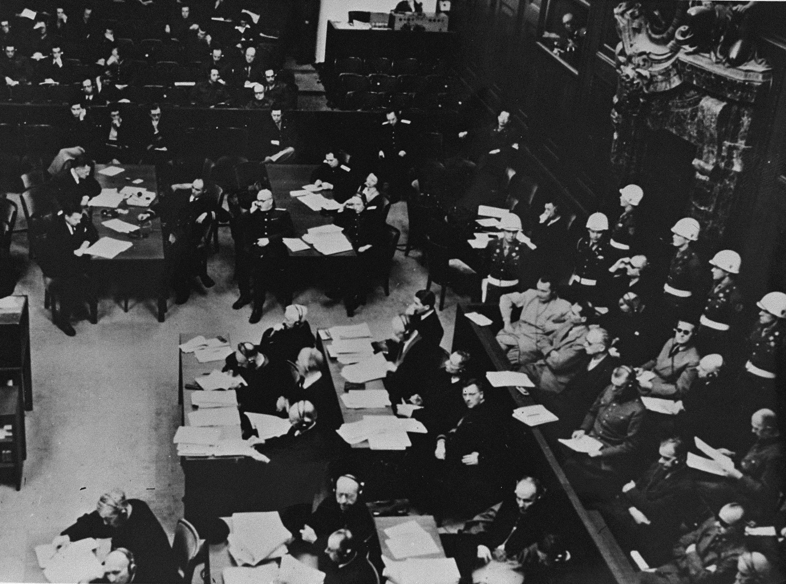 The defendants (right), their lawyers (bottom middle), and the French and Soviet prosecution tables (top middle and top left) at the International Military Tribunal trial of war criminals at Nuremberg.