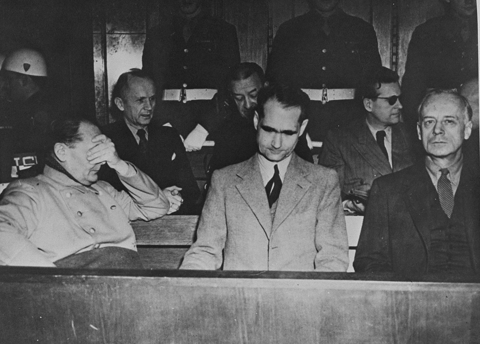 Defendants at the International Military Tribunal trial of war criminals at Nuremberg.  In the front row, left to right, are Hermann Goering, Rudolf Hess, and Joachim von Ribbentrop.  In the back row, left to right, are Karl Doenitz, Erich Raeder, and Baldur von Schirach.