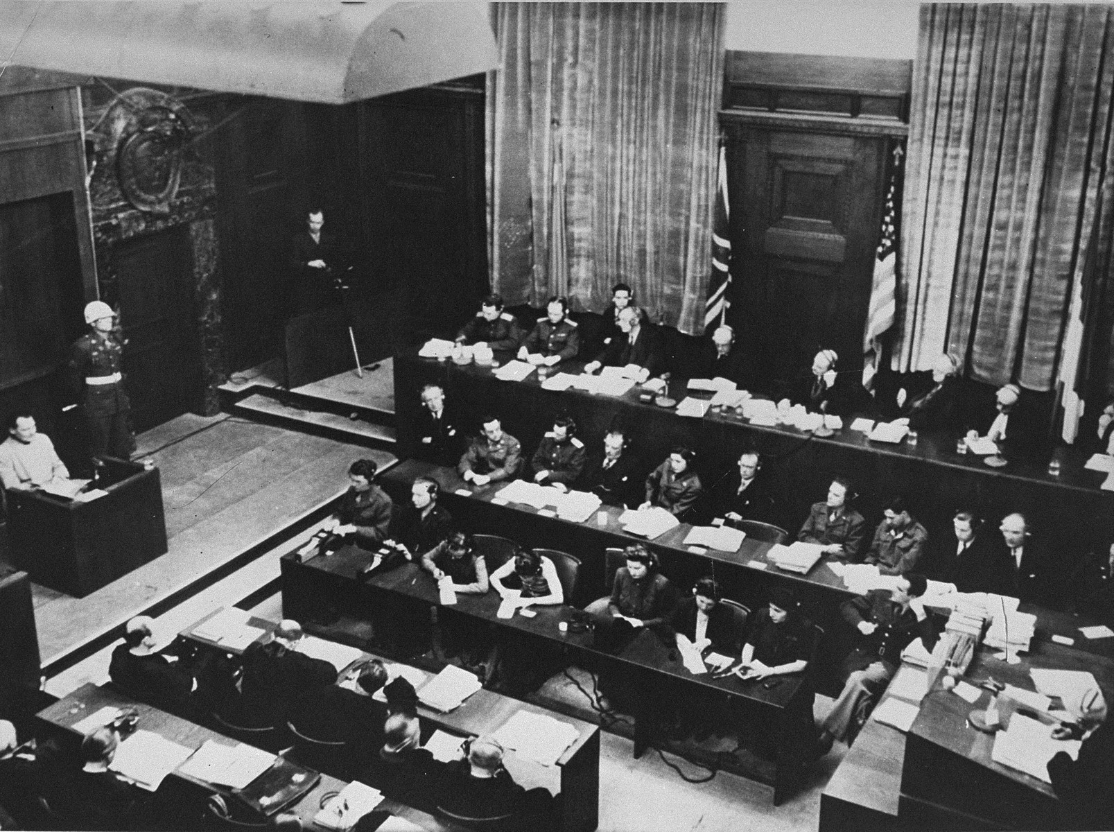 Hermann Goering testifies from the witness box at the International Military Tribunal trial of war criminals at Nuremberg.