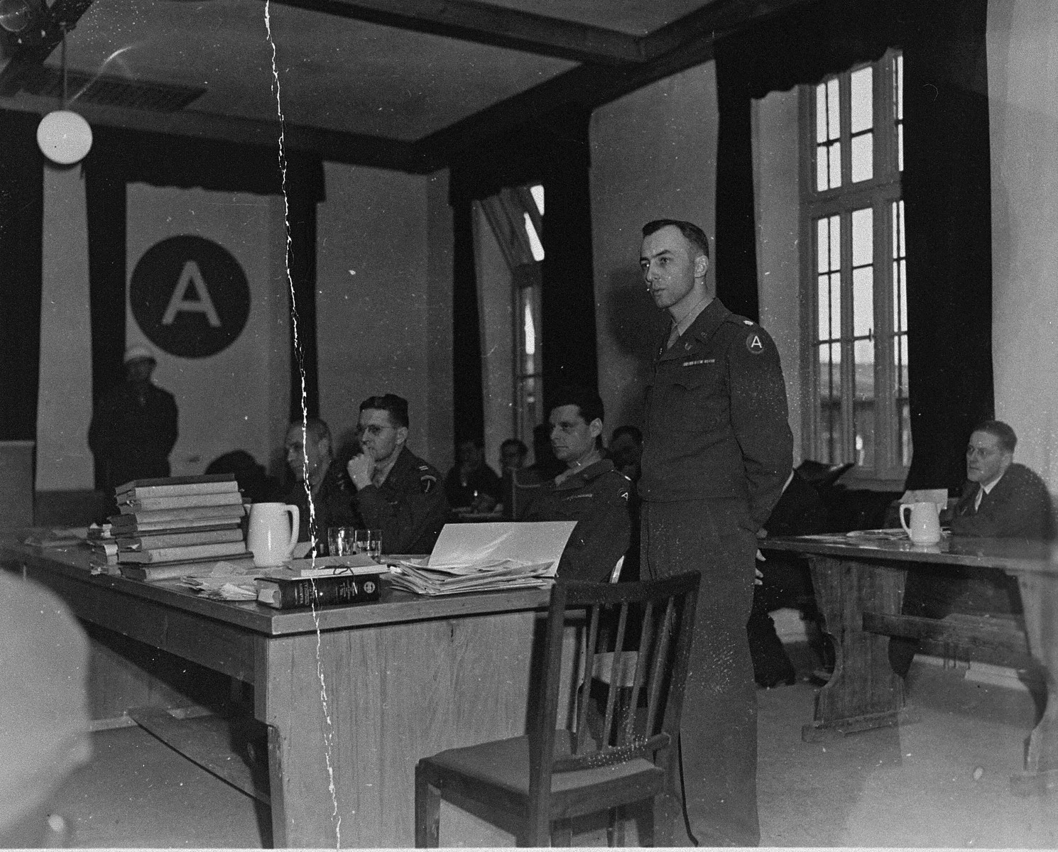 The American prosecution team at the trial of 61 former camp personnel and prisoners from Mauthausen.  Standing is William Denson.