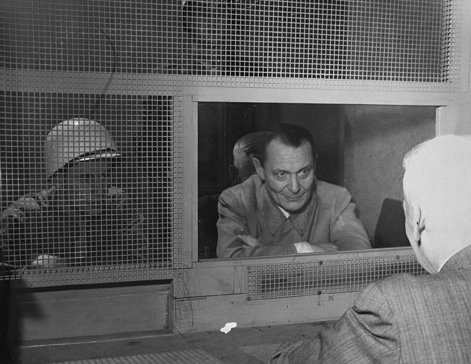 Defendant Hermann Goering consults with his lawyer, Dr. Otto Stahmer, in the Nuremberg prison at the International Military Tribunal trial of war criminals.  Also pictured is Theodore E. Glover.