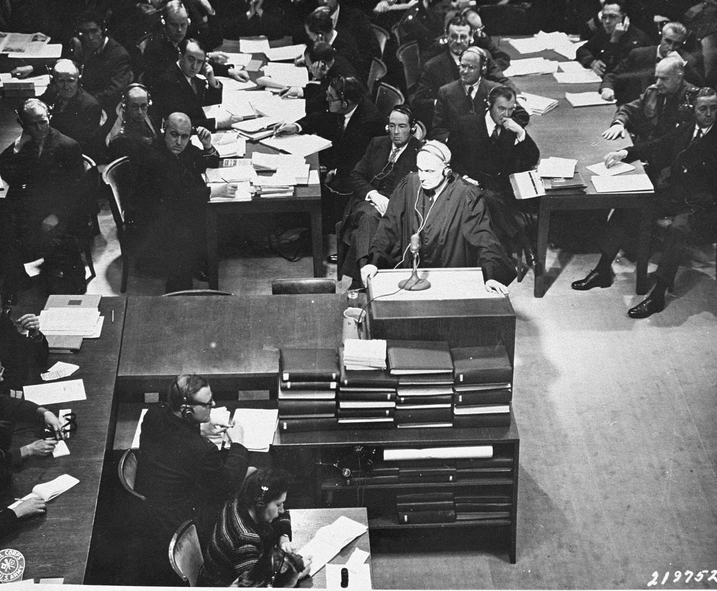 Defense attorney Dr. Otto Stahmer, the counsel for Hermann Goering, asks for a temporary adjournment so the defendants can speak with their counsellors at the International Military Tribunal trial of war criminals at Nuremberg.  As a result, court was adjourned for fifteen minutes.