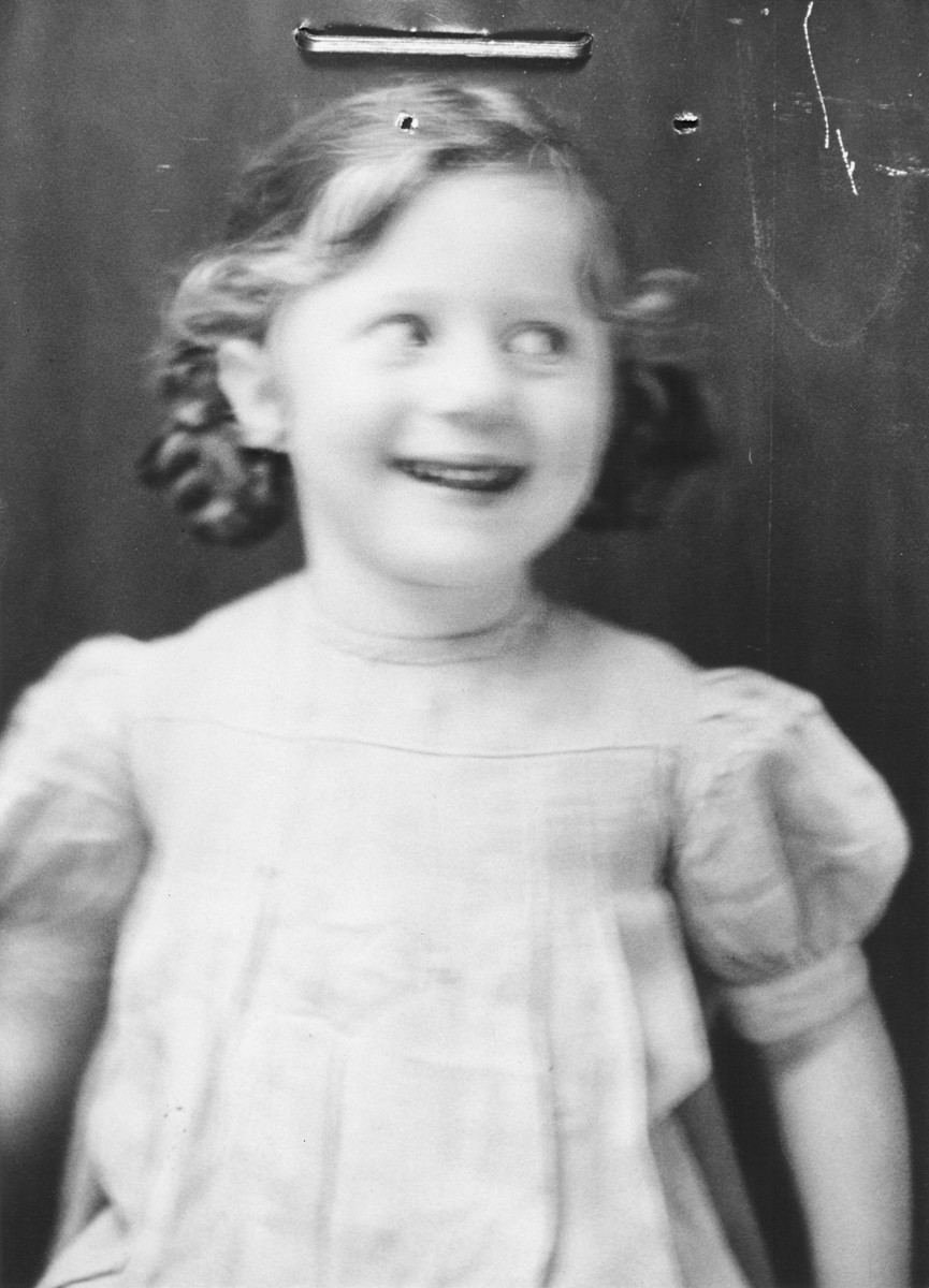 Portrait of a Jewish refugee child from Belgium taken by the Swiss police after she escaped with her family from occupied France into Switzerland in the fall of 1943.  Pictured is Frieda Wajsfeld.