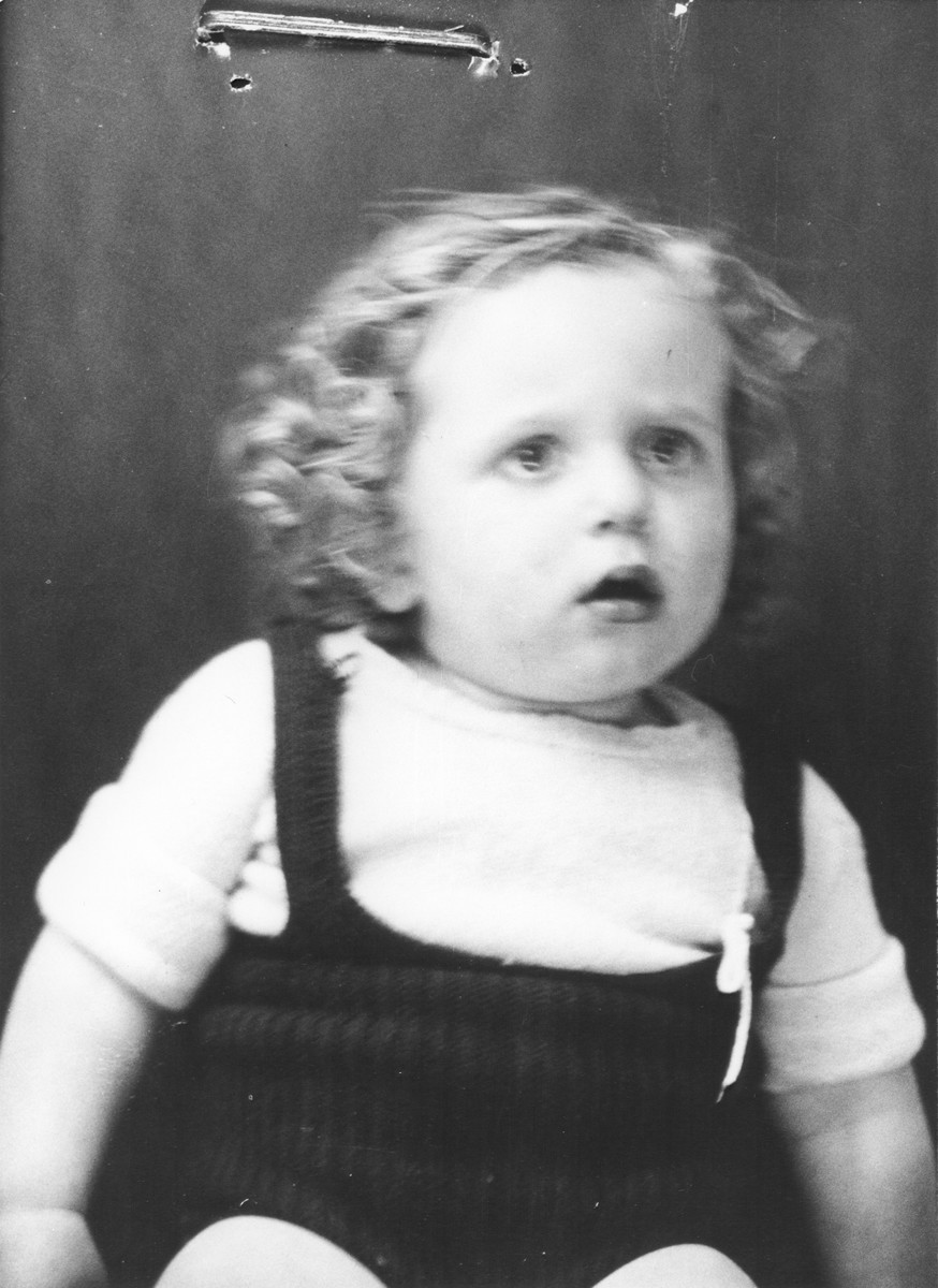 Portrait of a Jewish refugee child from Belgium taken by the Swiss police after he escaped with his family from occupied France into Switzerland in the fall of 1943.  Pictured is Simon Wajsfeld.