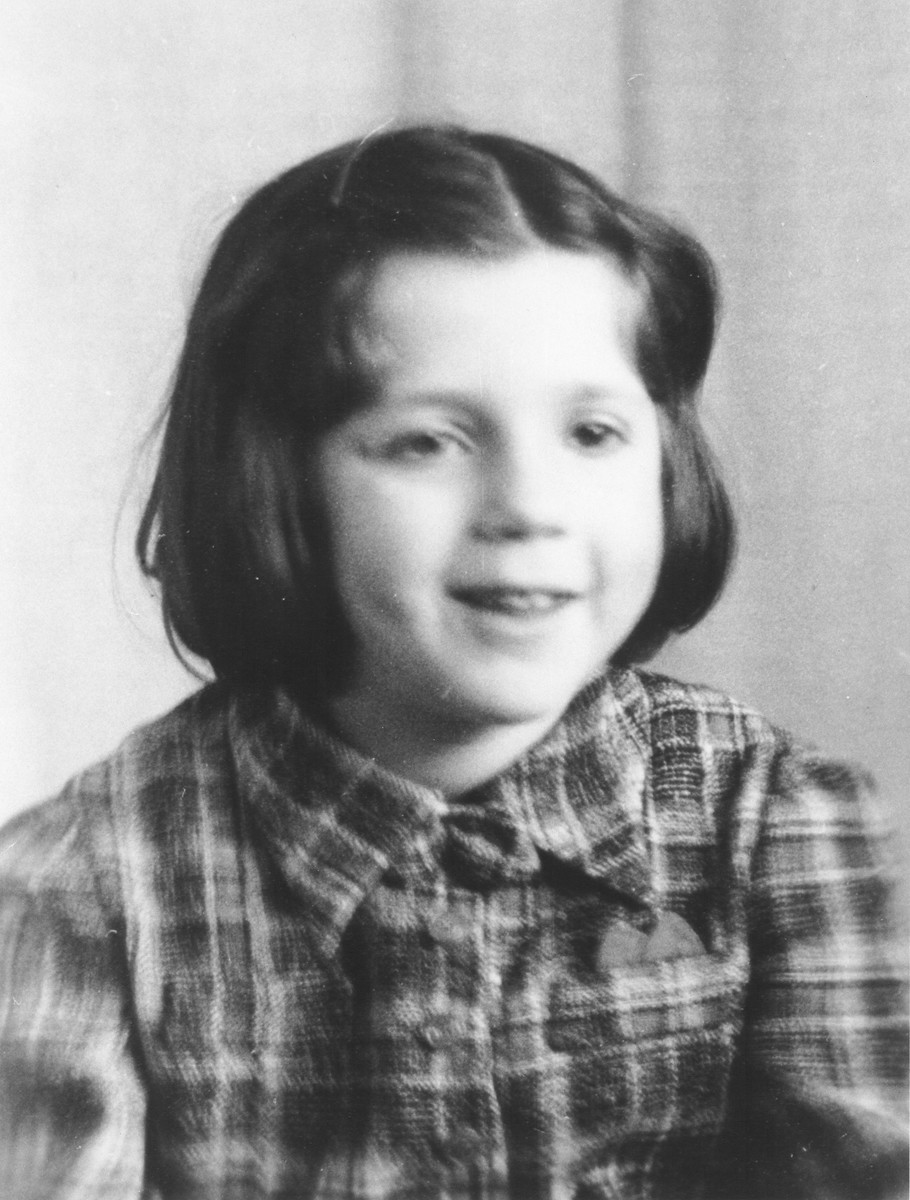 Portrait of a Jewish refugee child from Belgium taken by the Swiss police after she escaped with her family from occupied France into Switzerland in the fall of 1943.  Pictured is Lea Wajsfeld.