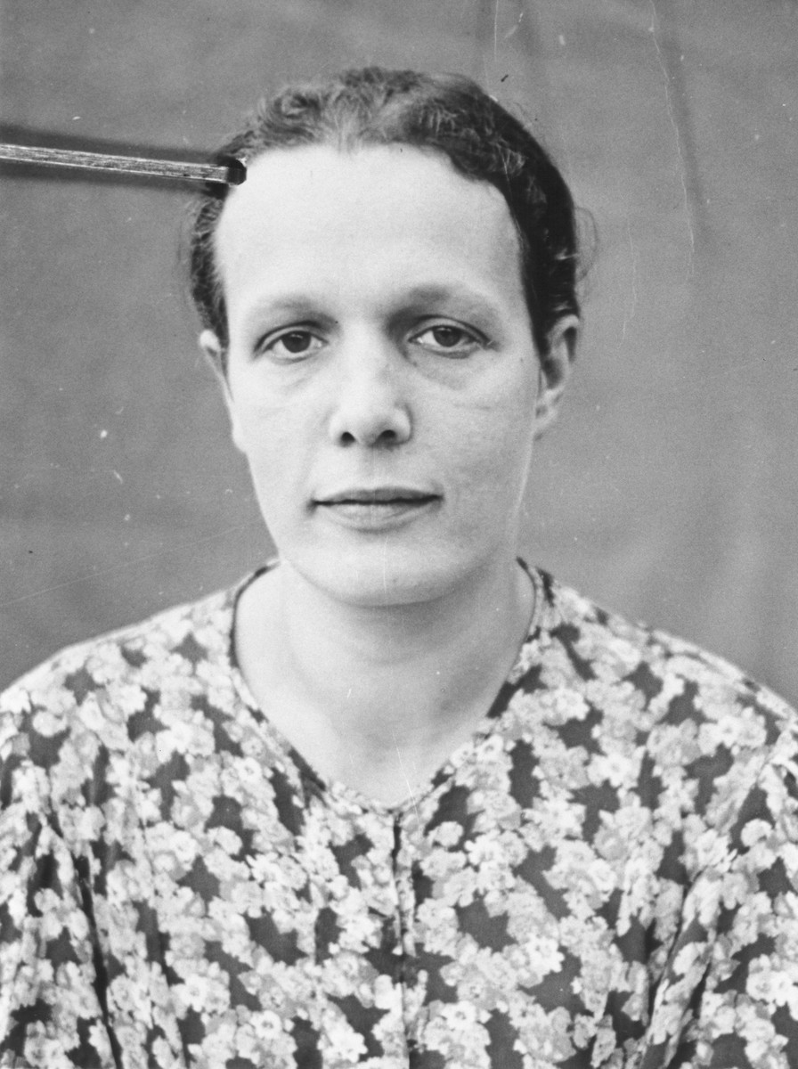 Portrait of a Jewish refugee  from Belgium taken by the Swiss police after she escaped with her family from occupied France into Switzerland in the fall of 1943.  Pictured is Hinde Wajsfeld.