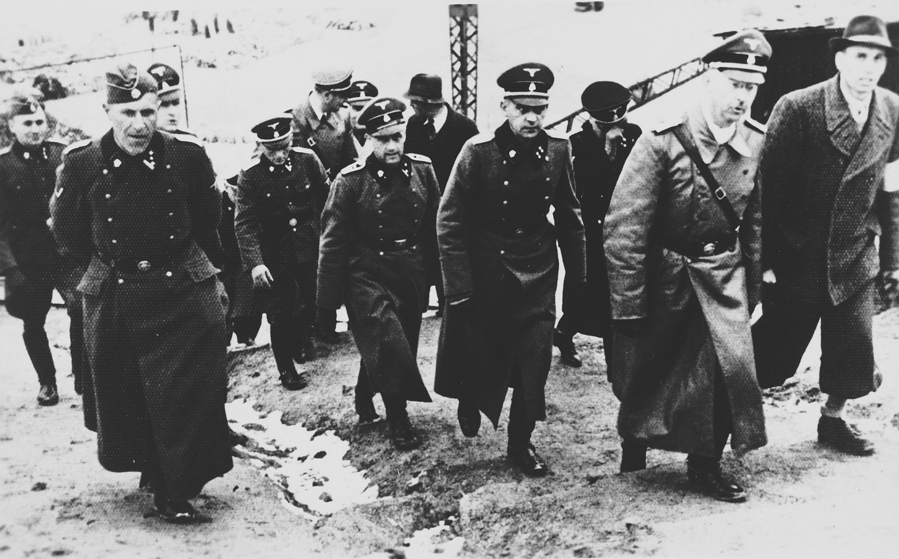 Heinrich Himmler inspects the Flossenbuerg concentration camp.  Heinrich Himmler is pictured on second from the right.  He is accompanied by his new adjutant Ludwig Baumgartner and Hans Huettig, who was responsible for the camp post office and censorship.  Also pictured is Schutzhaftlagerfuehrer Hans Aumeier.
