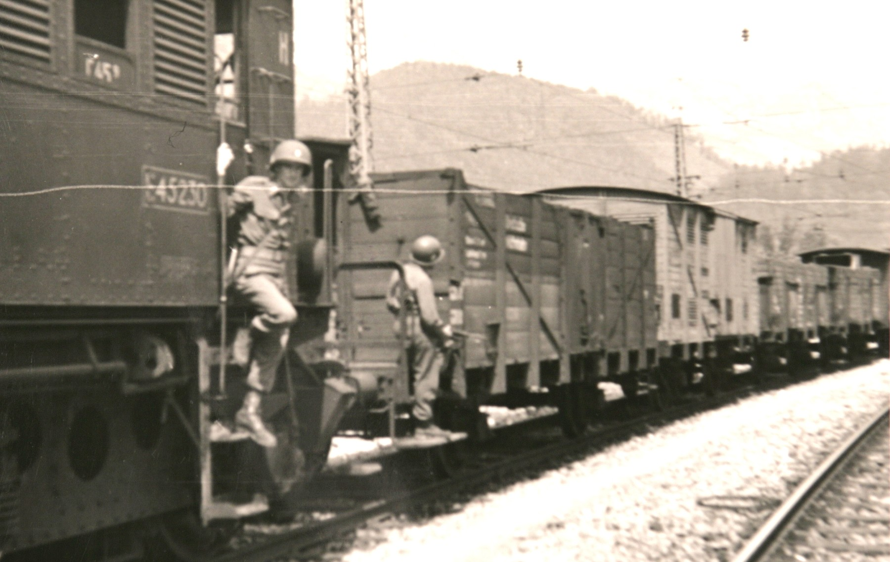 """American soldiers guard the Hungarian Gold Train in Werfen, Austria, soon after the American occupation authorities took custody of the train.  The original caption reads: """"Train with evacuated Hungarian art treasures."""""""