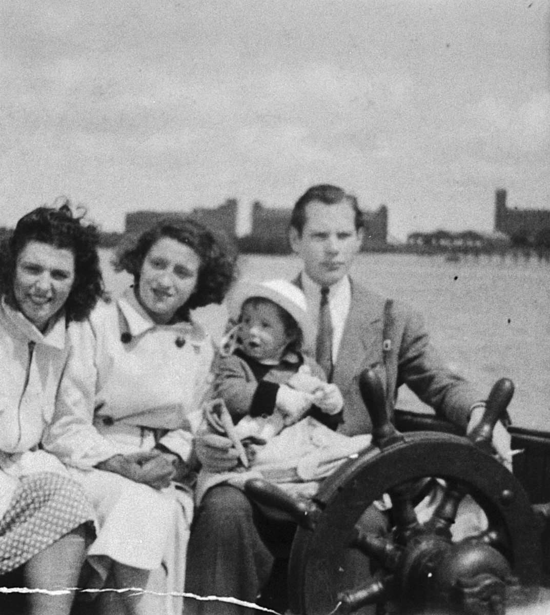 Members of the Belgian resistance take a young Jewish child they are hiding for a boat ride.  Pictured are Andree Ermel, Floris Desmedt, and Myriam Frydland.