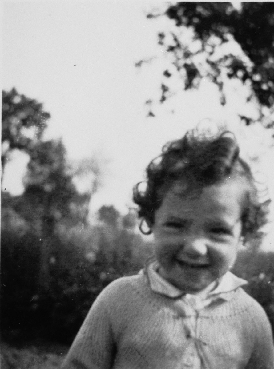 Close-up portrait of a young Jewish child in hiding.  Pictured is Myriam Frydland.