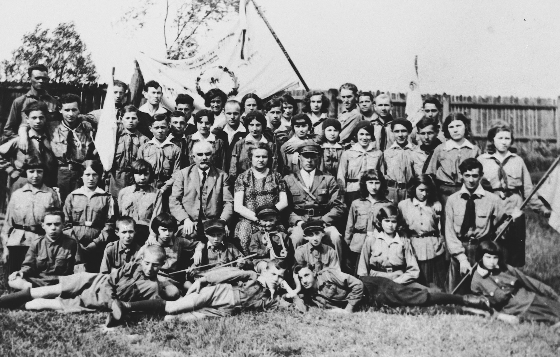 Children in a Zionist youth movement in Dabrowa Gornicza pose with flags and bugles.