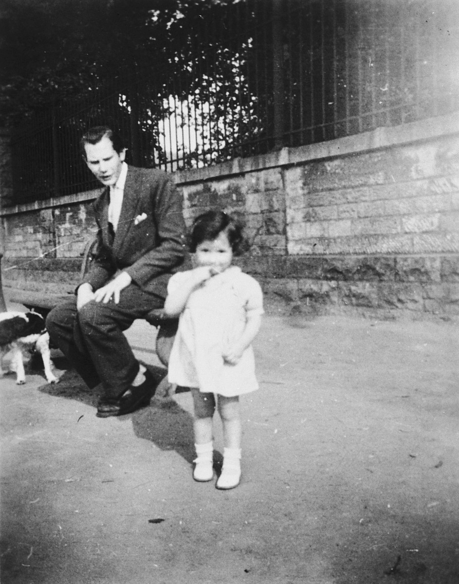 A member of the Belgian resistance takes a young Jewish child he is helping to hide to the park.  Pictured are Floris Desmedt and Myriam Frydland.
