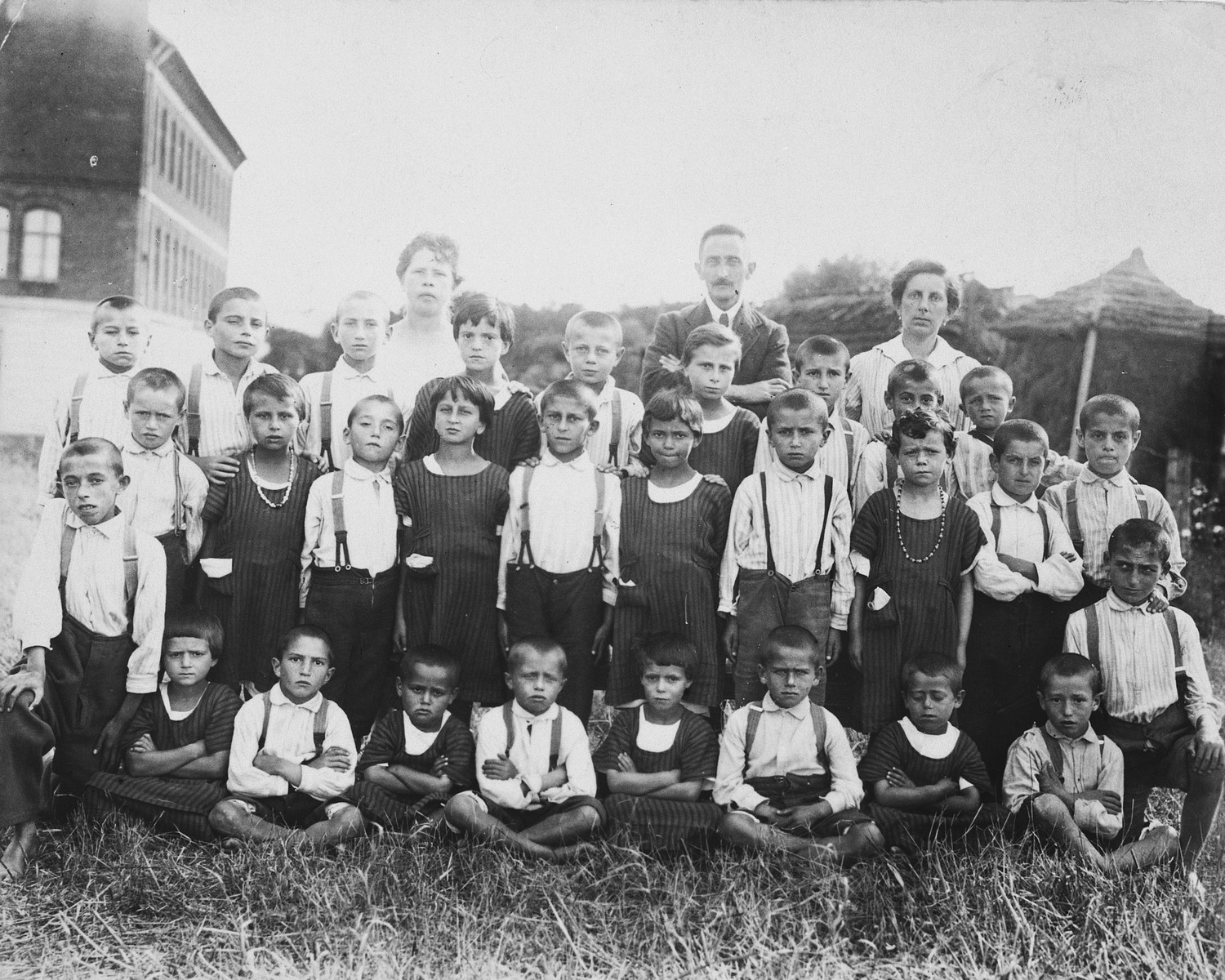 Group portrait of children and staff of the Jewish orphanage in Drohobycz.