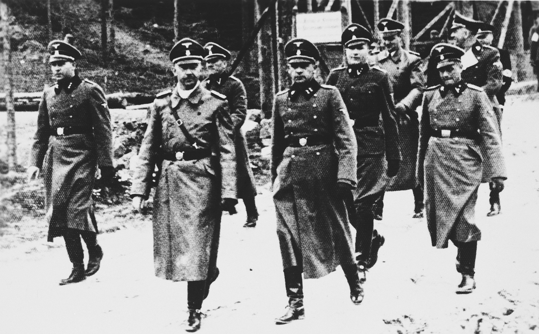 Heinrich Himmler goes on an inspection tour of the Flossenbuerg concentration camp.  Heinrich Himmler is pictured second from the left.  To his right the camp commandant Karl Künstler, to his far right the adjutant Ludwig Baumgartner. In the back: Karl Wolff and Oswald Pohl (from left).