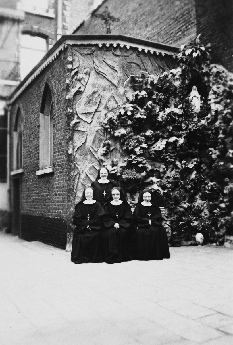 Group portrait of the nuns of the Couvent Du Tres Saint Sauveur who were responsible for hiding fifteen Jewish children.  The mother superior, Sister Marie Amelie, is in the center.