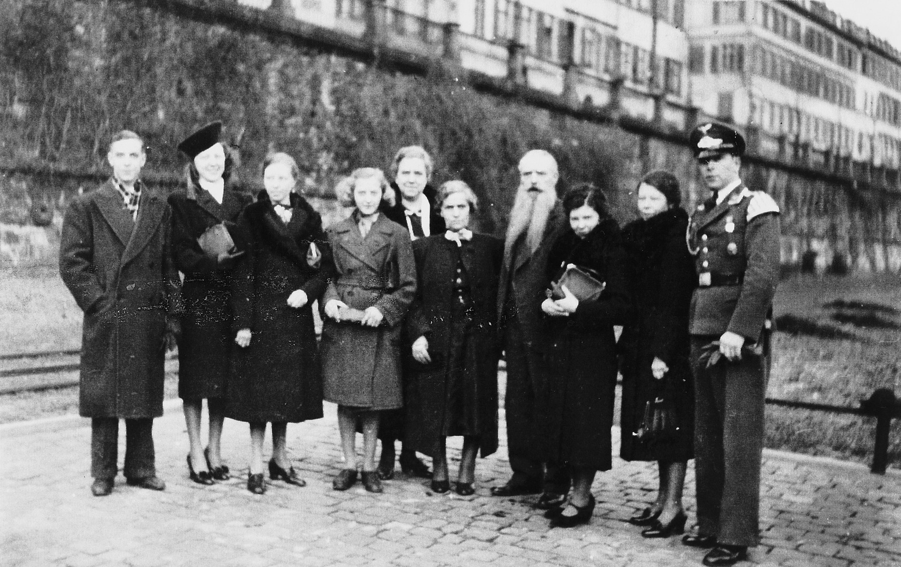 Portrait of a large intermarried German-Jewish family.  From left to right are Werner, Maria, Karola, Hilde, Else, Johanna, Karl, Erna, Rosa, and Willy in his Luftwaffe Music Corps uniform.