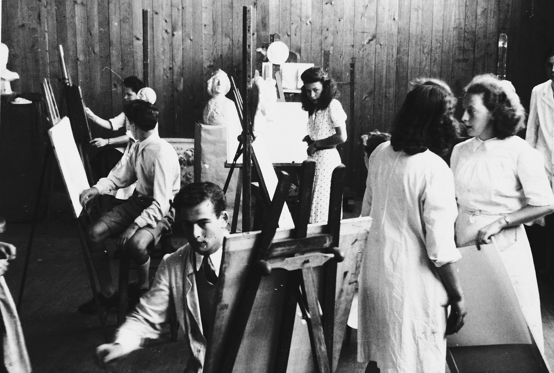 Students work in the studio of the Ecole des Beaux-Arts in Geneva, Switzerland.  Lucie Eisenstab is standing in the back, and Paul Peter Porges is seated in the front, left.