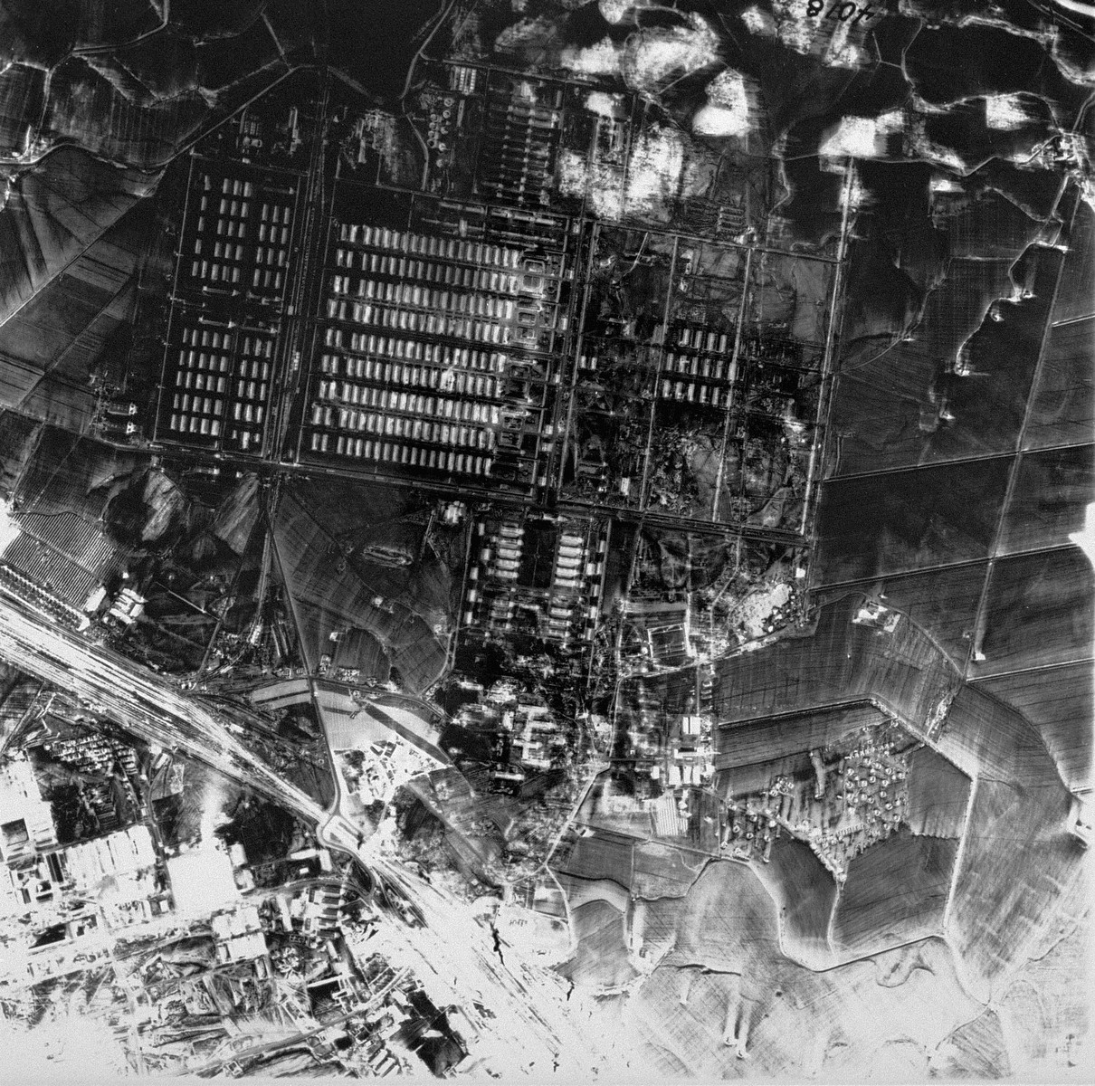 An aerial reconnaissance photograph showing Auschwitz II (Birkenau). [oversized photograph]
