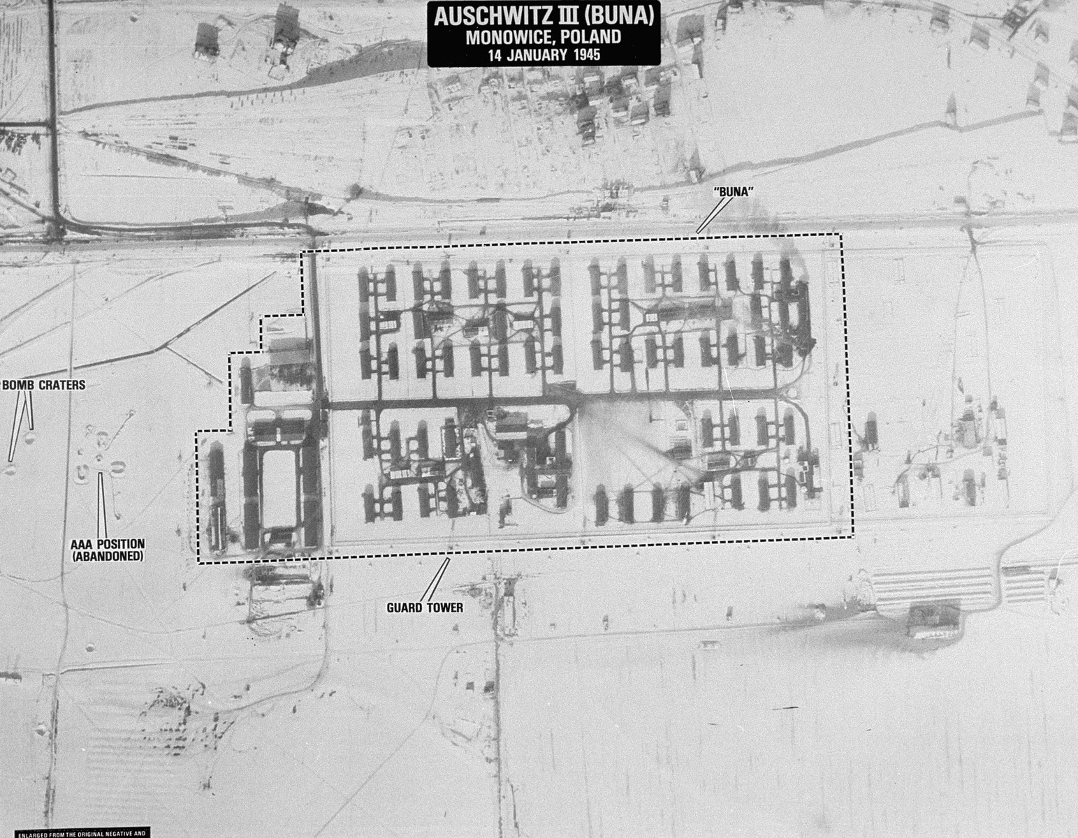 An aerial reconnaissance photograph of the Auschwitz concentration camp showing the Auschwitz III (Buna plant).
