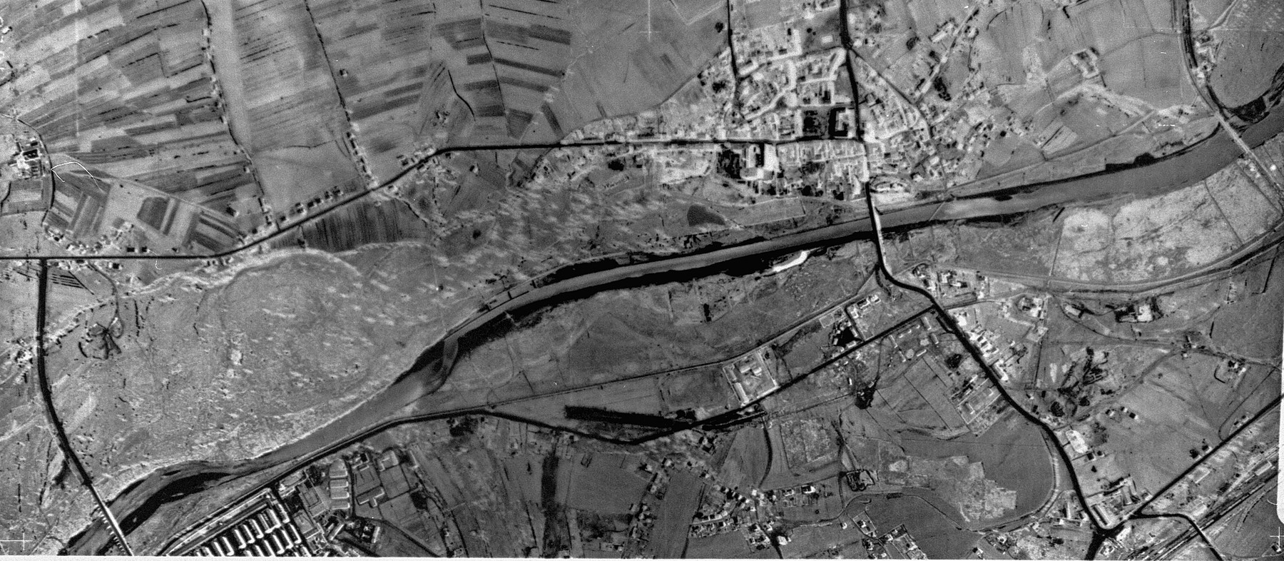 An aerial reconnaissance photograph of the Auschwitz area showing a small corner of  Auschwitz I .  The town of Oswiecim appears in the middle of the image.