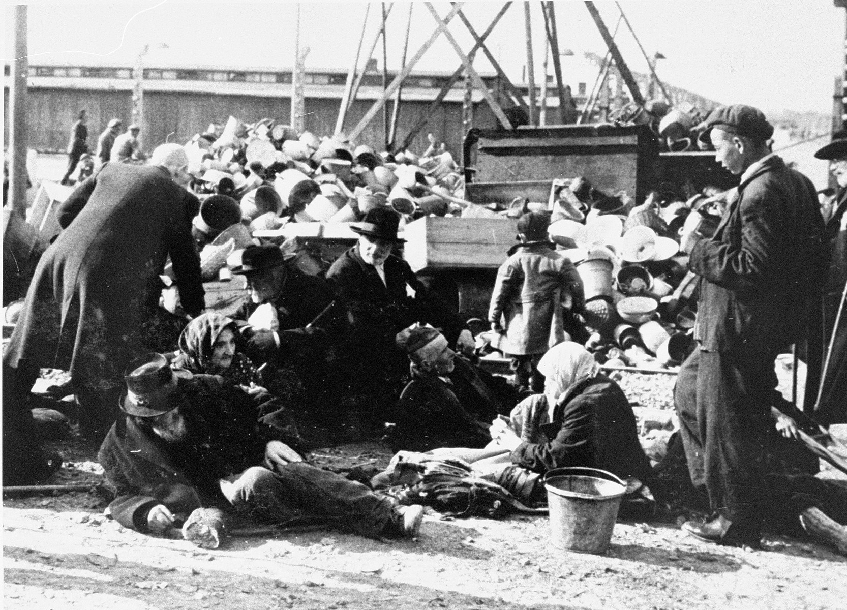 Elderly Jews from Subcarpathian Rus who have been selected for death at Auschwitz-Birkenau wait to be transported to the gas chambers.  Standing on the far right is Mendel, the cousin of Lili Jacob.
