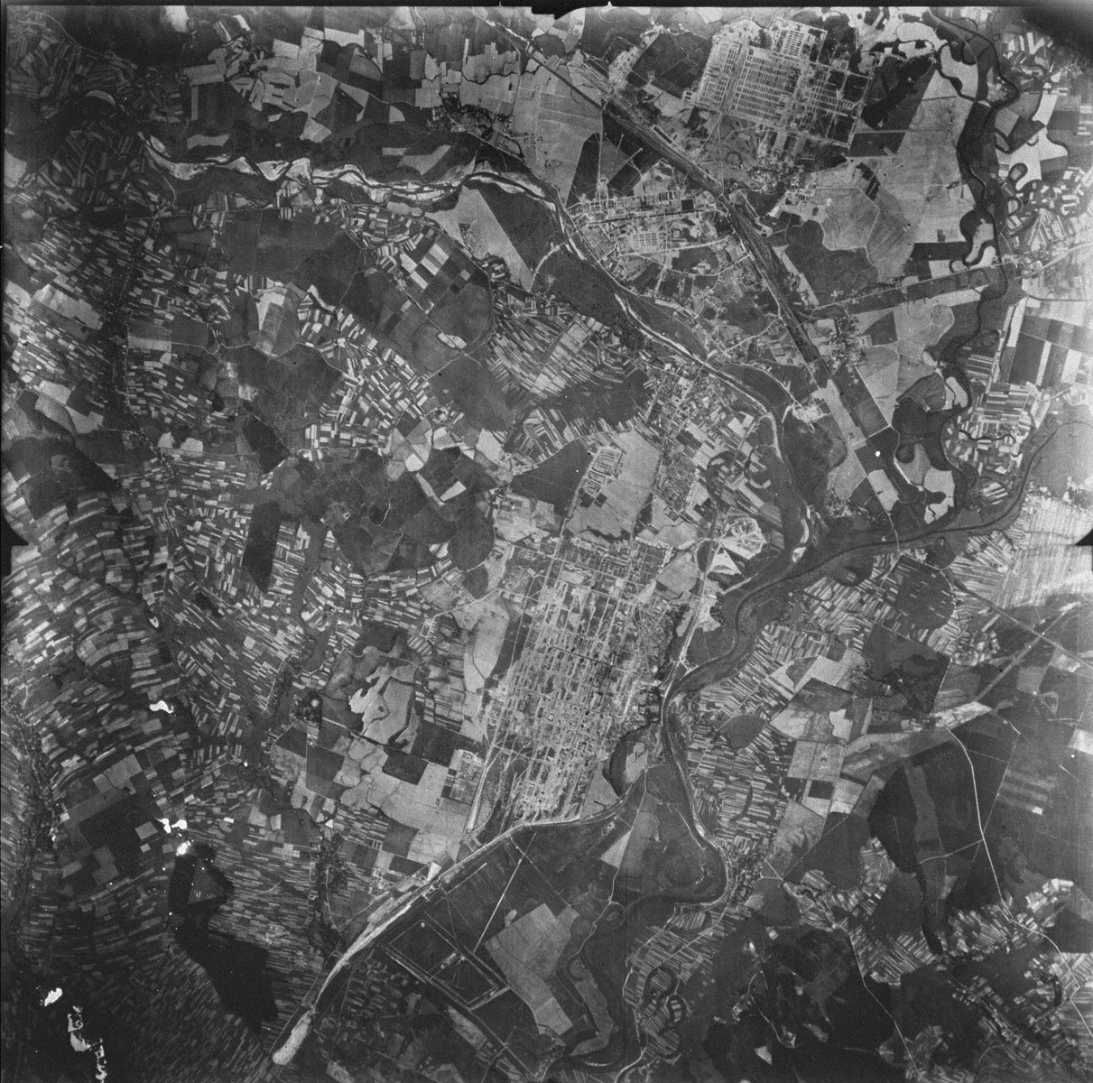 "An aerial reconnaissance photograph of the Auschwitz area showing the three main camps , Auschwitz I, Auschwitz II (Birkenau), and Auschwitz III (Monowitz), as well as the I.G. Farben complex. The image demonstrates the relative size of the three camps.  [oversized photograph]  Mission:  60 PRS/462 60 SQ;  Scale: 1/54,000;  Focal Length: 6"";  Altitude: 27,000'"