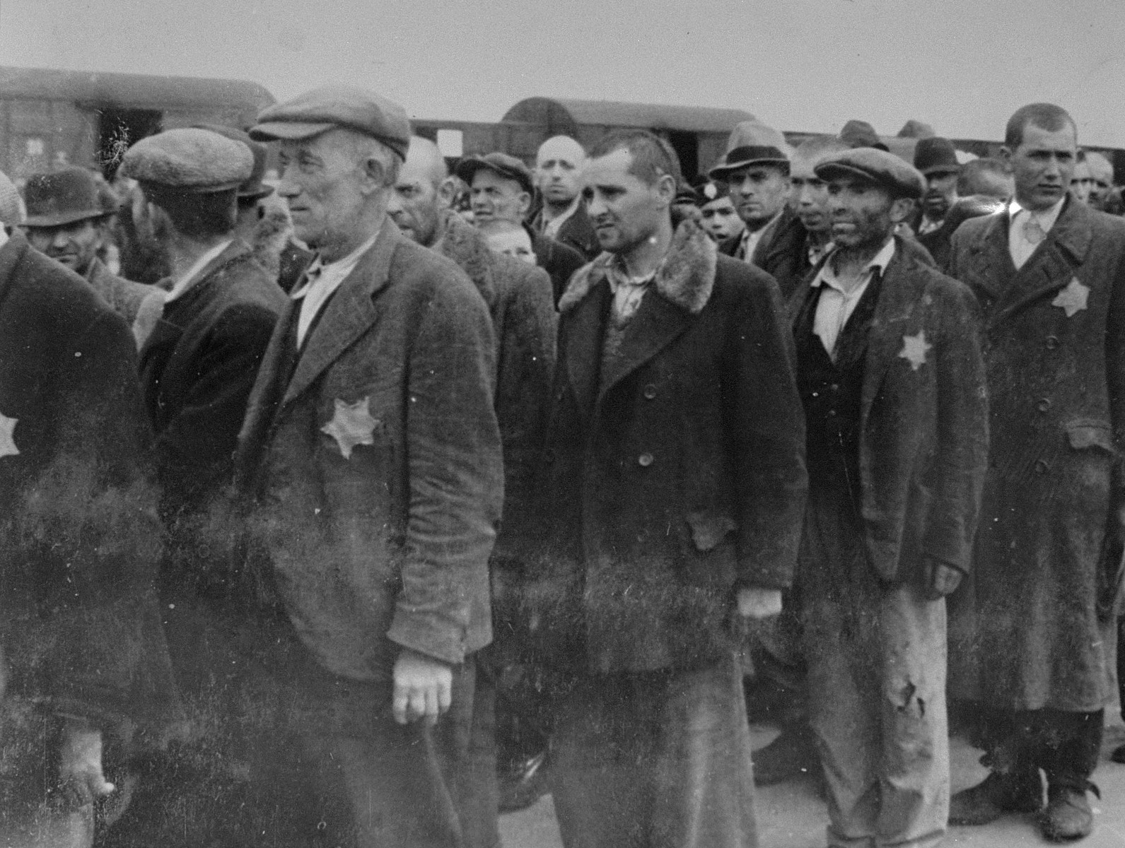 Jewish men from Subcarpathian Rus await selection on the ramp at Auschwitz-Birkenau.