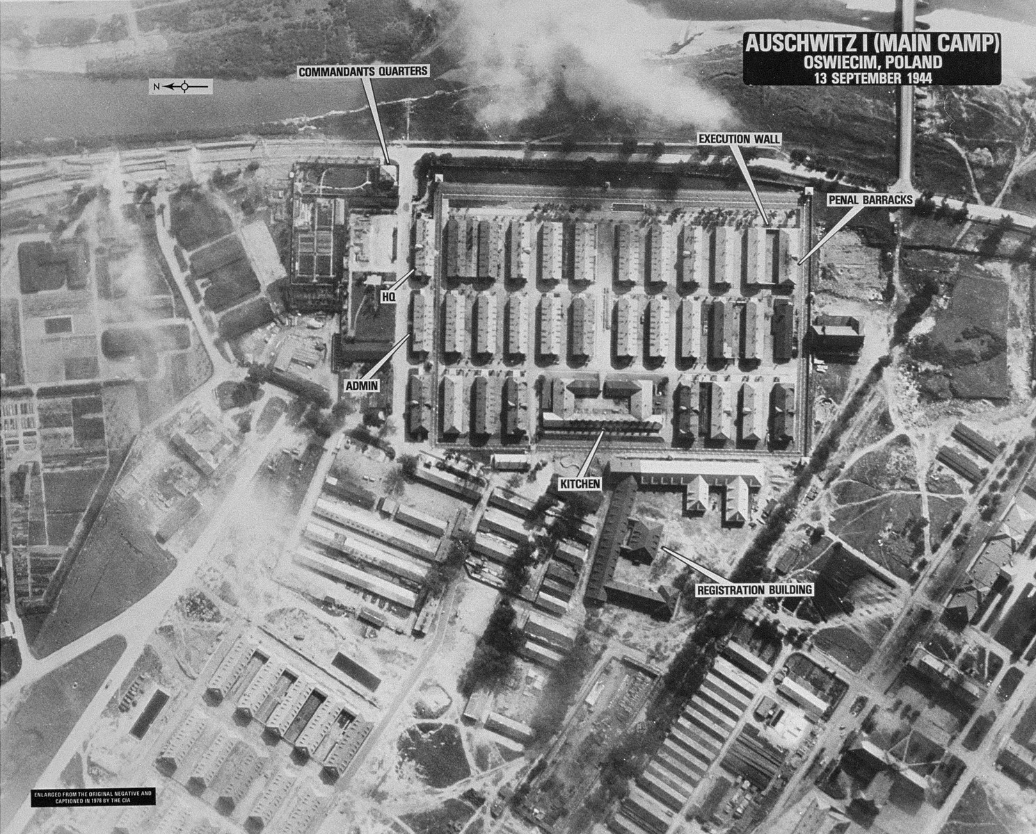 "An aerial reconnaissance photograph of the Auschwitz concentration camp showing the Auschwitz I camp. Mission:  464 BG:4M97;  Scale: 1/23,000;  Focal Length: 12"";  Altitude: 23,000'."