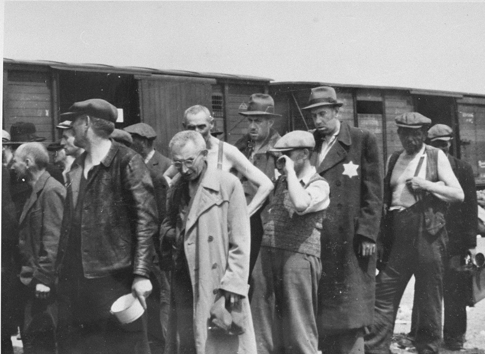 Jewish men from Subcarpathian Rus await selection on the ramp at Auschwitz-Birkenau.