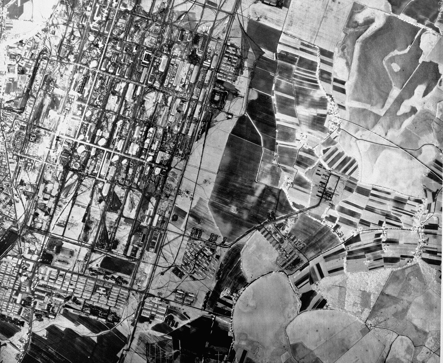 "An aerial reconnaissance photograph showing the I.G. Farben ""Buna"" plant at Auschwitz with the Auschwitz III (Monowitz) prisoners camp."