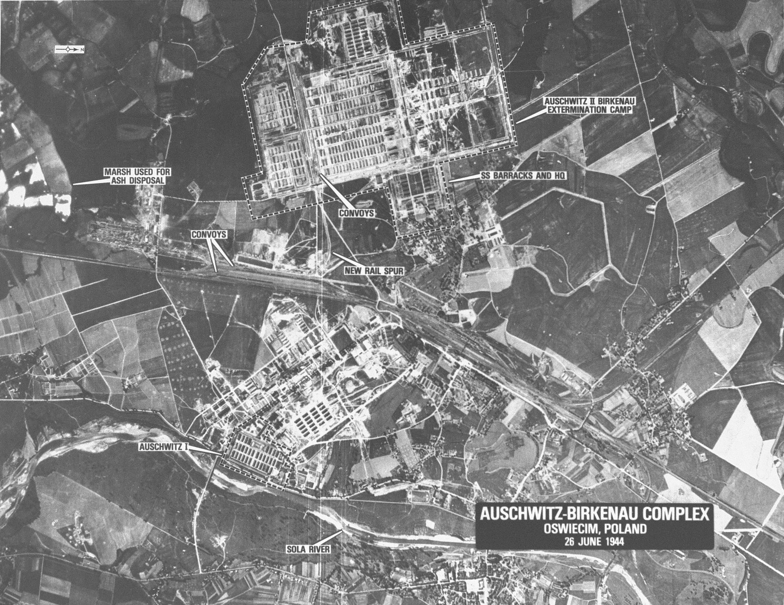 "An aerial reconnaissance photograph of the Auschwitz concentration camp showing Auschwitz I and Auschwitz II (Birkenau).  Mission:  60 PR/522 60 SQ;  Scale: 1/60,000;  Focal Length: 6"";  Altitude: 30,000'."