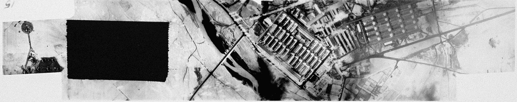 An aerial reconnaissance photograph showing Auschwitz I  including the barracks and administration building.