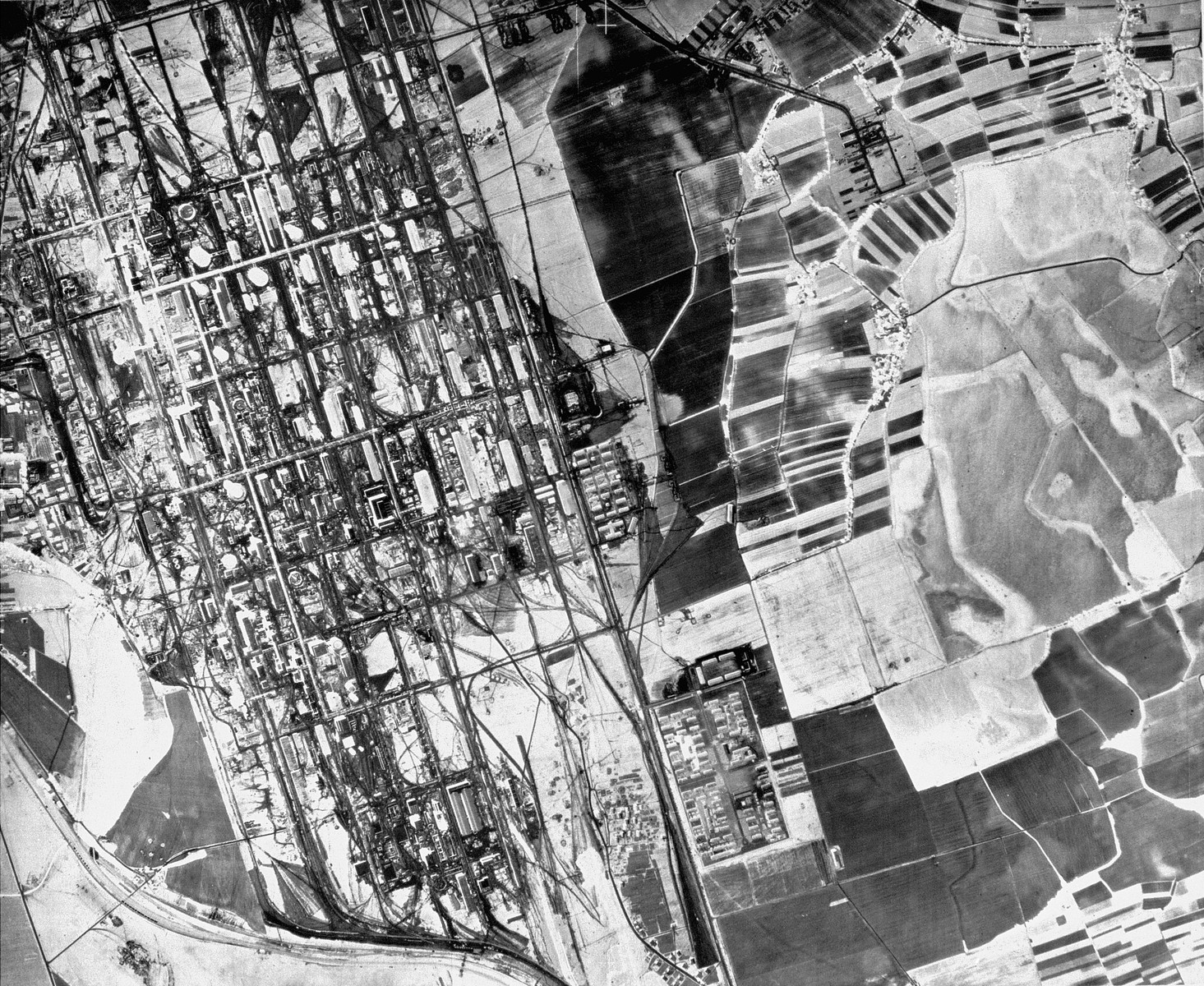 "Aerial photograph of the Auschwitz area showing a partial view of the I.G. Farben plant and the associated Monowitz (Auschwitz III) concentration camp.  Mission:  60 PRS/462 60 SQ;  Scale: 1/54,000;  Focal Length: 6"";  Altitude: 27,000'"