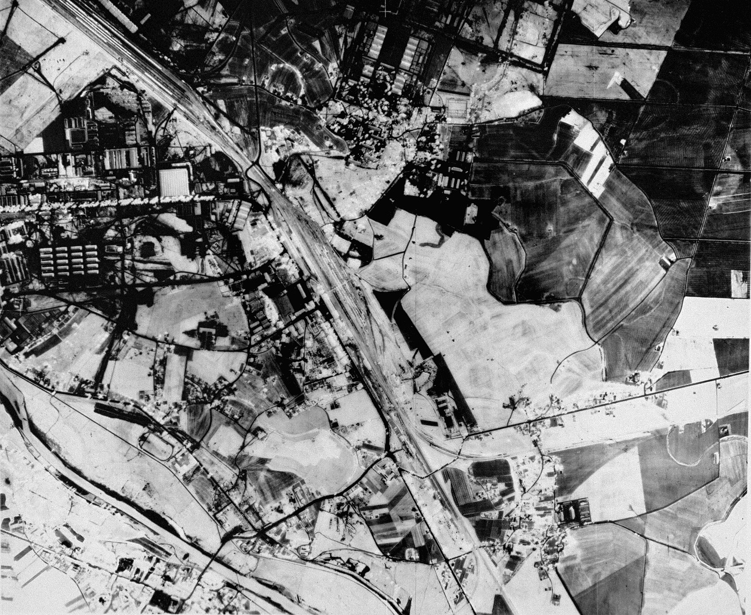 An aerial reconnaissance photograph of  Auschwitz I showing the rail lines leading to the camp.