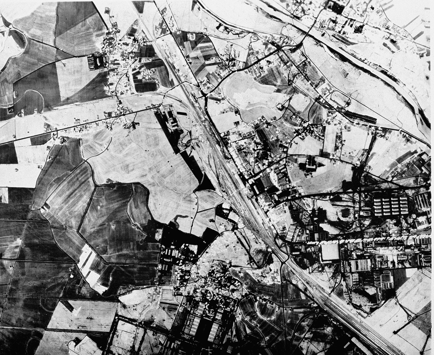 An aerial reconnaissance photograph of  Auschwitz I showing the administrative area as well as the railway lines to the camp.