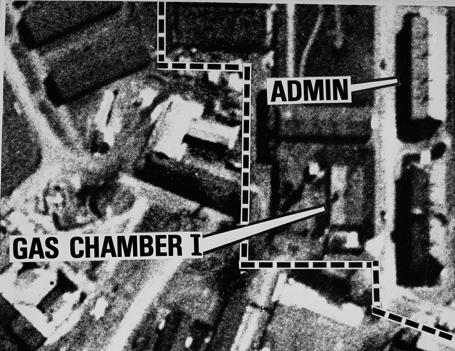 An enlarged aerial reconnaissance photograph of  Auschwitz I  showing the administration building and gas chamber.