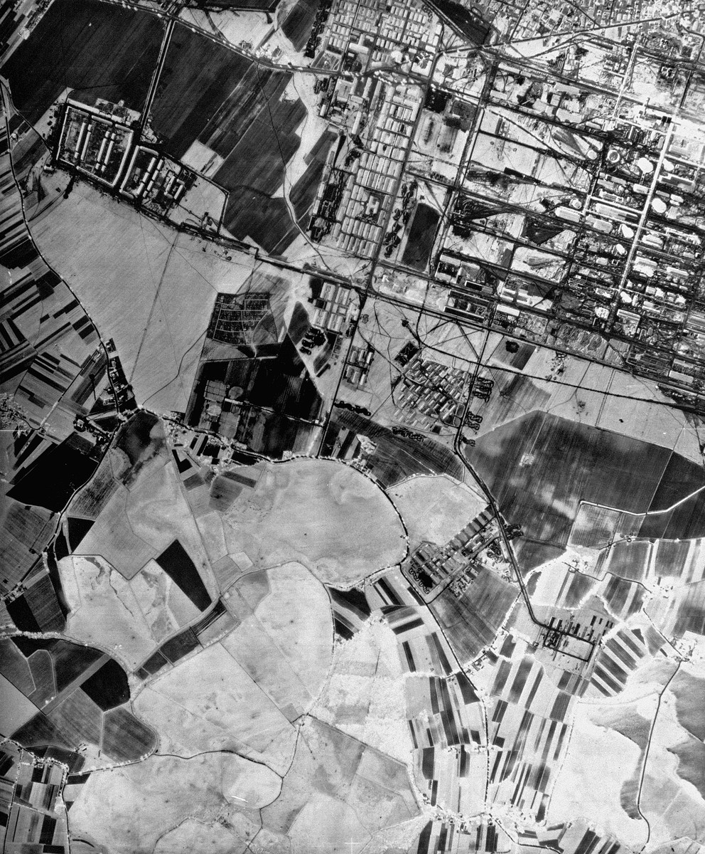 "An aerial reconnaissance photograph showing the I.G. Farben ""Buna"" plant at Auschwitz on the left, with the Auschwitz III (Monowitz) prisoners camp. Camp numbers VII, Lehringsheim, III, VIII and IX  are shown as well, all under construction."