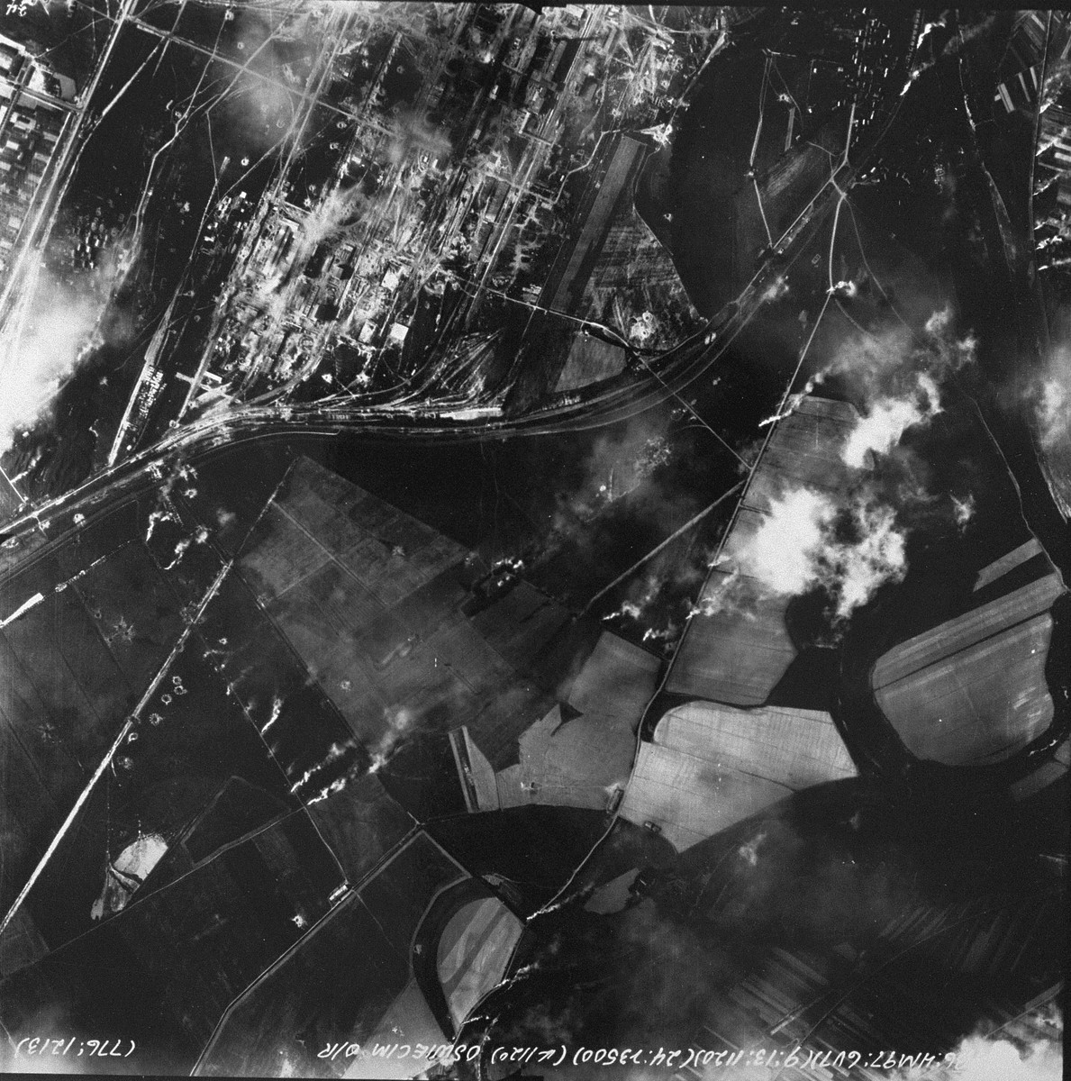 "An aerial reconnaissance photograph showing Auschwitz III (Monowitz) and a part of the IG Farben ""Buna"" complex.  [oversized photograph]"