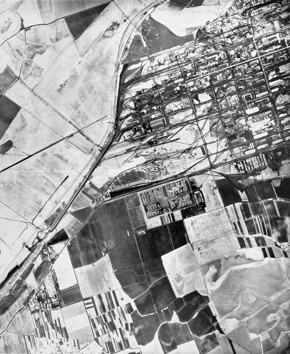 "A partial aerial reconnaissance view showing the I.G. Farben ""Buna"" plant and the Auschwitz III (Monowitz) prisoner area."