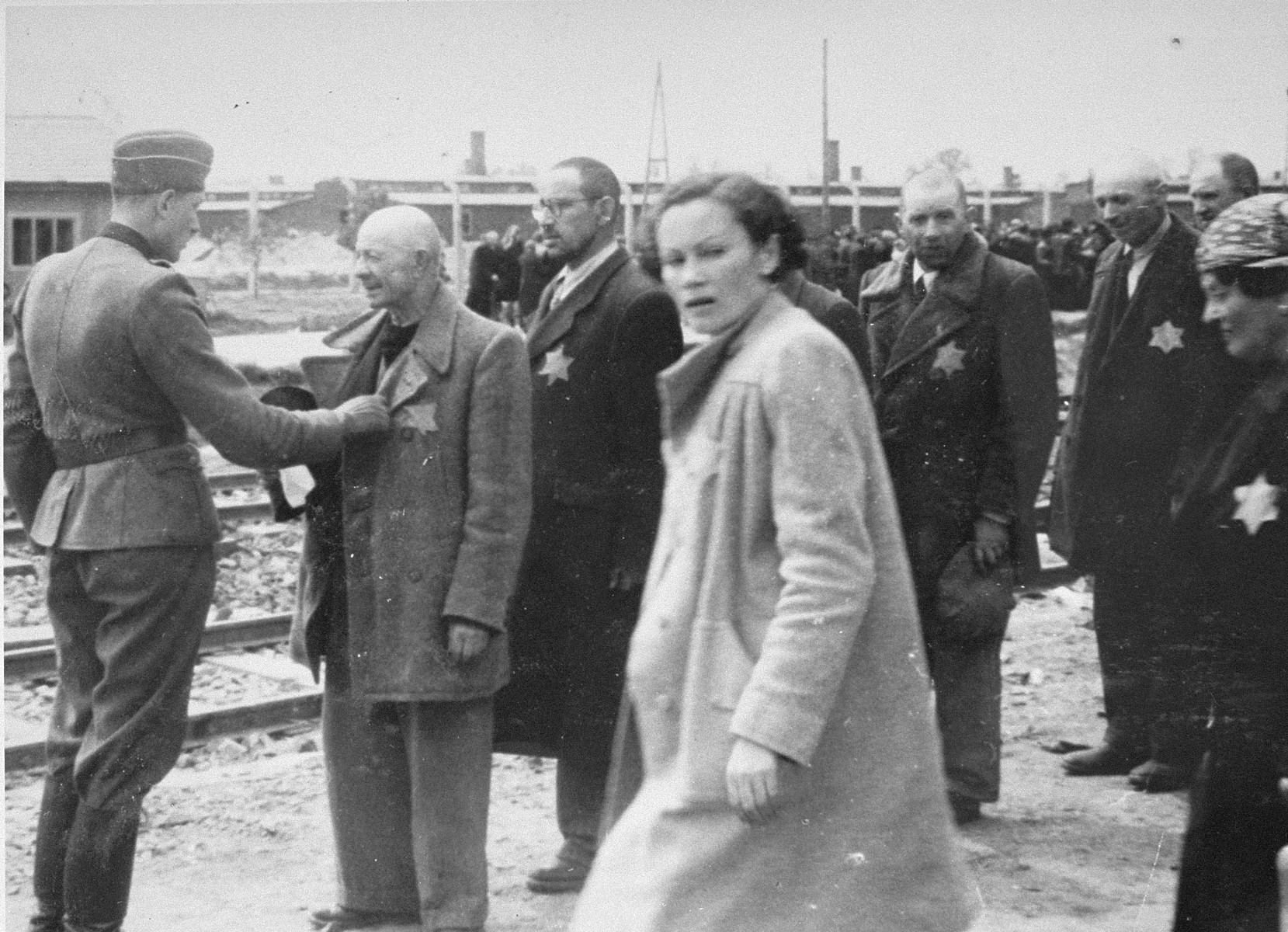 Jews from Subcarpathian Rus undergo a selection on the ramp at Auschwitz-Birkenau.  In front of him is Geza Lajtbs of Budapest.