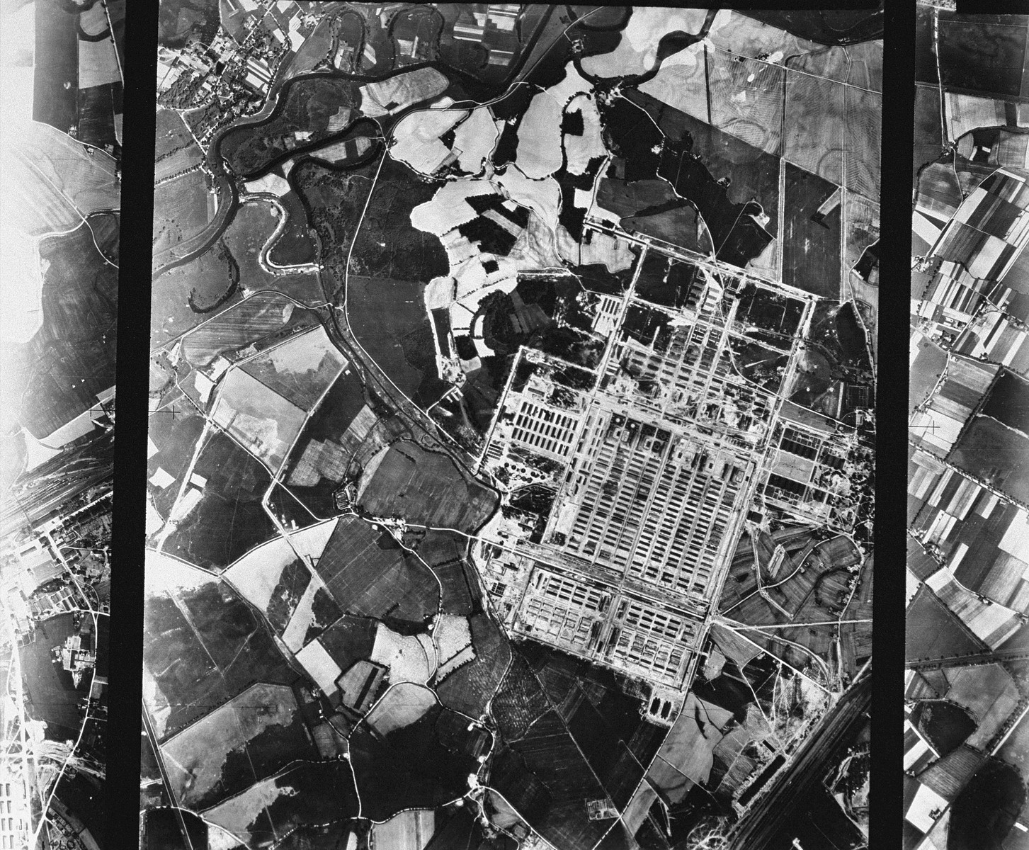 "An aerial reconnaissance photograph showing Auschwitz II (Birkenau). [oversized photograph]  Mission:  60 PRS/462 60 SQ;  Scale: 1/54,000;  Focal Length: 6"";  Altitude: 27,000'"