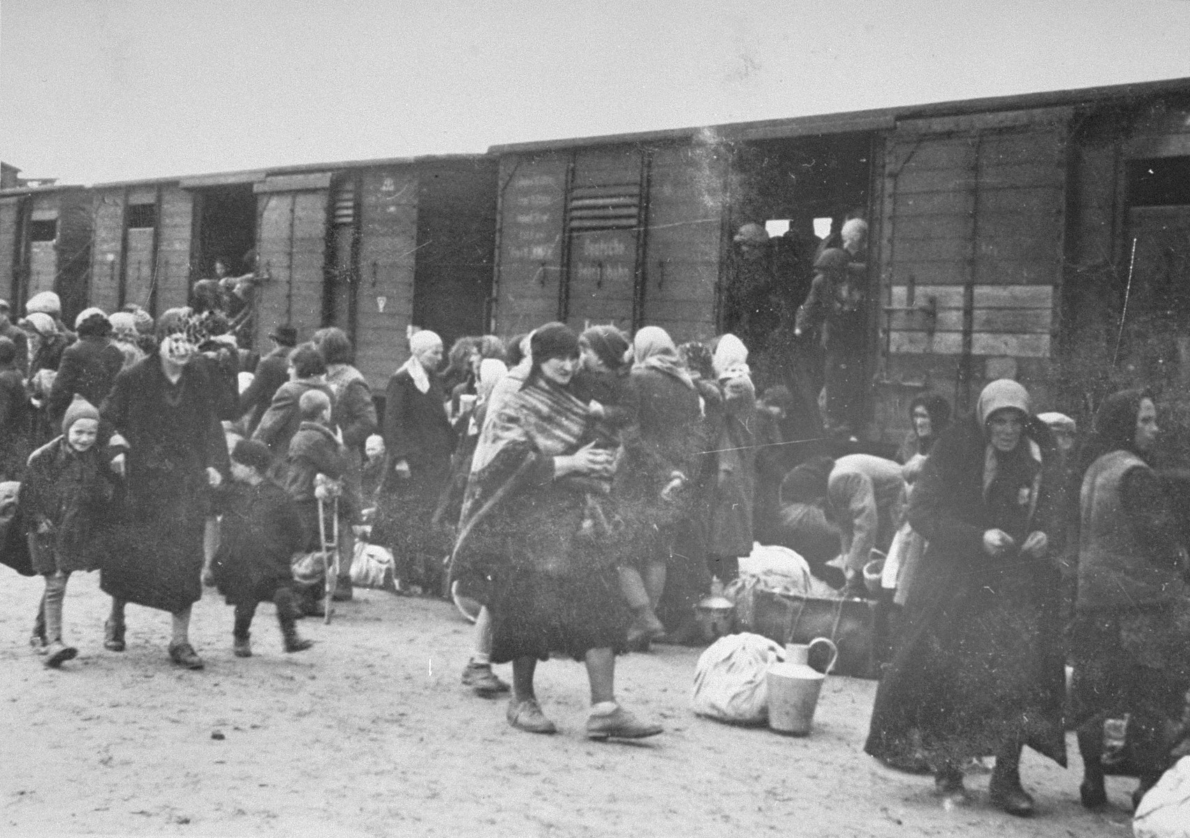 Jews from Subcarpathian Rus get off the deportation train and assemble on the ramp at Auschwitz-Birkenau.