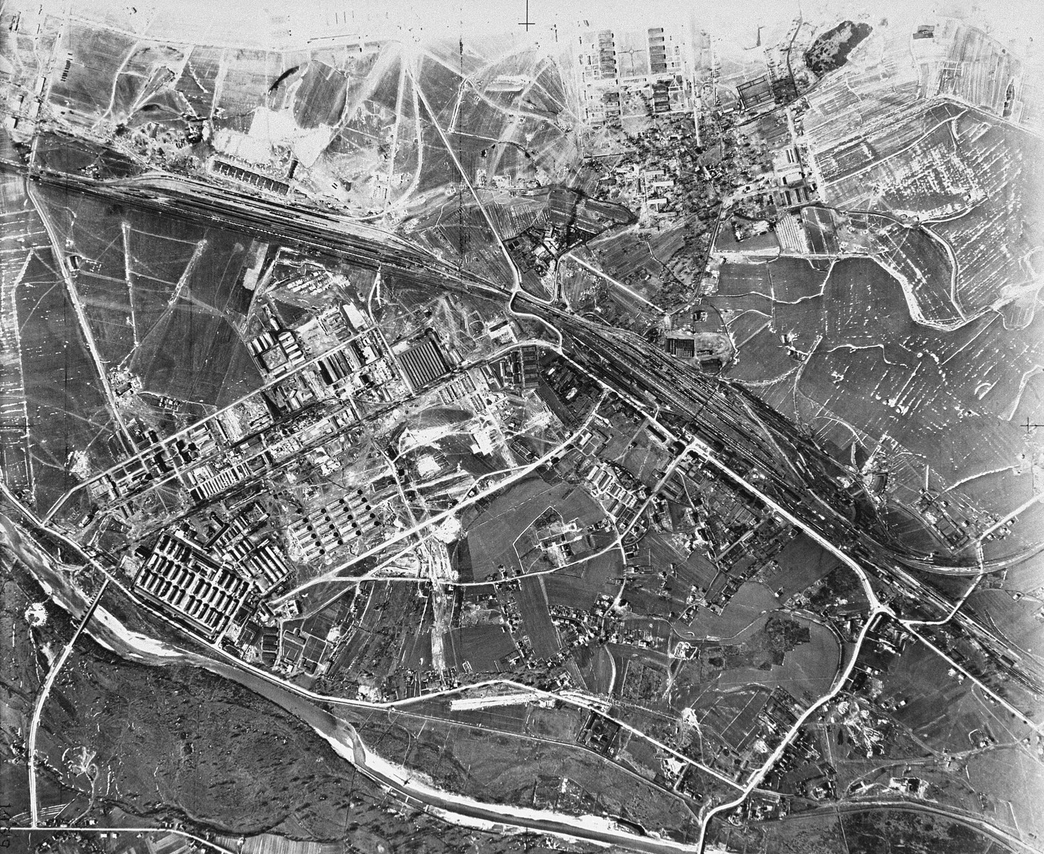 "An aerial reconnaissance photograph of the Auschwitz area showing the Auschwitz I camp. [Oversized photo]  Mission:  60 PR 288 60 SQ;  Scale: 1/15,569;  Focal Length: 20"";  Altitude: 26,000'"