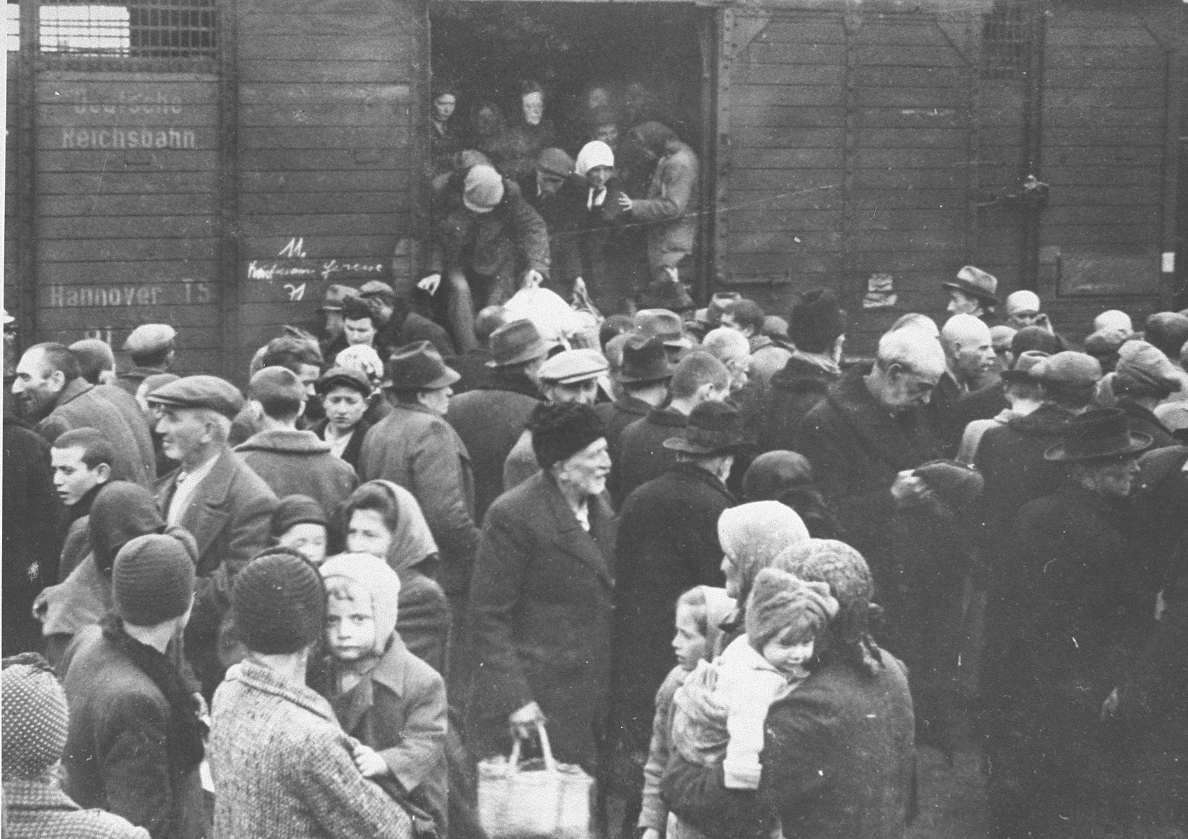 A transport of Jews from Subcarpathian Rus is taken off the trains and assembled on the ramp at Auschwitz-Birkenau.  Pictured in the center is Yitzhak Rubin.