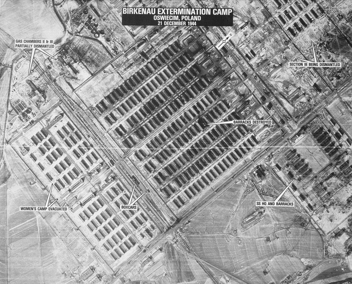 "An aerial reconnaissance photograph of the Auschwitz concentration camp showing the Auschwitz II (Birkenau) camp. Mission:  15SG/994 5PG or 15SG/997 5PG;  Scale: 1/12,500;  Focal Length: 24"";  Altitude: 25,000';"