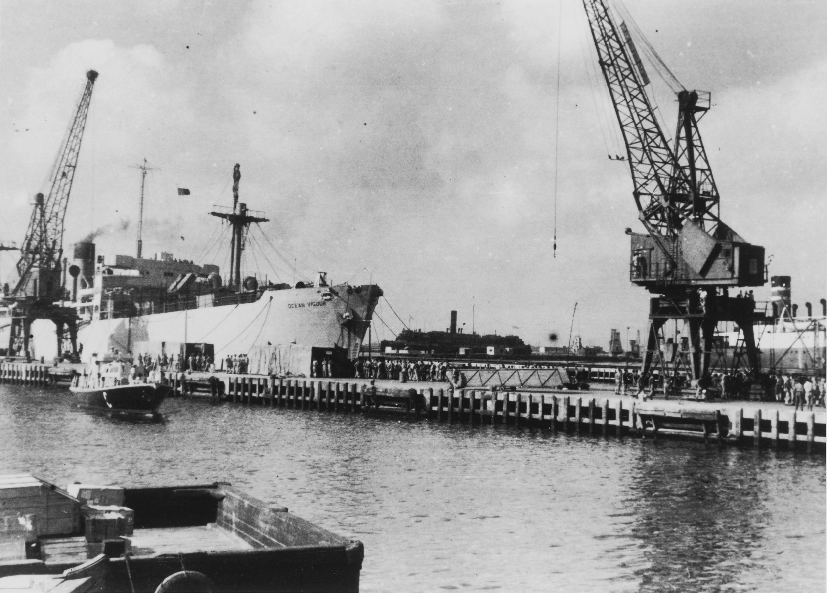 """The British """"comfort ship,"""" Ocean Vigour, stands in Haifa harbor ready to receive the passengers of the illegal immigrant ship, Exodus 1947."""