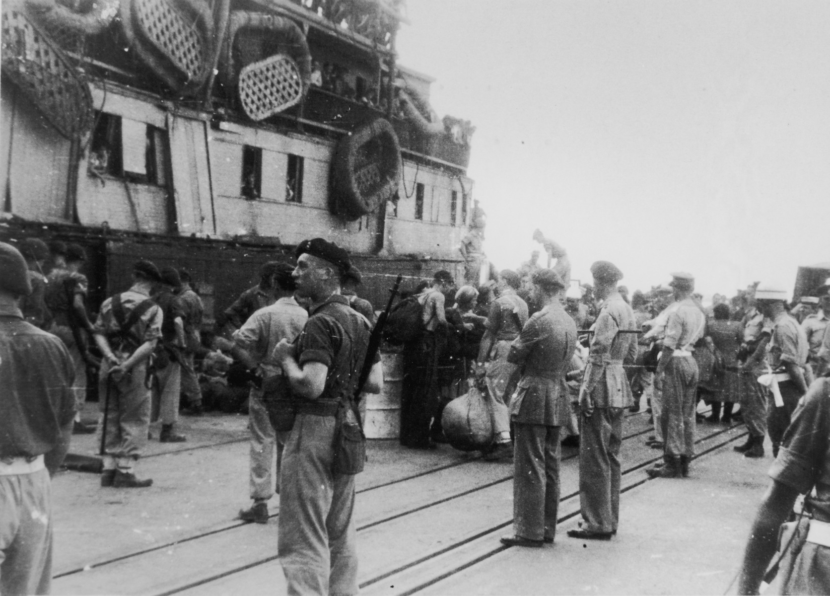 British soldiers on the pier in Haifa harbor oversee the offloading of passengers from the illegal immigrant ship, Exodus 1947.