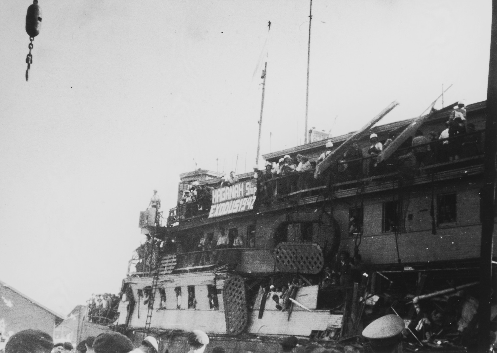The battered illegal immigrant ship, Exodus 1947, docks in Haifa harbor.